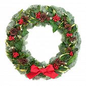 Winter and Christmas wreath with snow covered spruce pine fir, red bow, mistletoe, pine cones, cedar poster