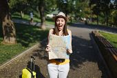 Young Shocked Traveler Tourist Woman In Yellow Casual Clothes Hat With Suitcase Scream Holding City  poster