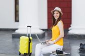 Beautiful Traveler Tourist Woman In Hat With Suitcase Sit Using Work On Laptop Pc Computer Looking A poster