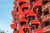Facade Of A Modern Red Apartment House With Many Balconies Seen In Berlin, Germany poster