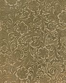 image of leather tool  - Suede pattern is floral with negative spaces that are burnished so the pattern seems embossed - JPG