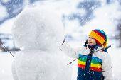 Kids Build Snowman. Children In Snow. Winter Fun. poster