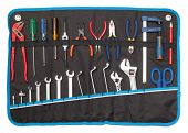 Toolbelt with set of tools - screwdrivers nippers wrenches spanners pliers  scissors isolated on whi poster