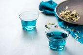 Blue Butterfly Pea Flowers Tea In A Glass On Table poster