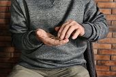 Poor Elderly Man Counting Coins, Focus On Hands poster
