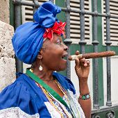HAVANA-MAY 19:Lady smoking a huge cigar May 19,2011 in Havana.Iconic characters like this are an att