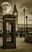 picture of big-ben  - Sepia image of The Big Ben in London with a bright full moon and a phone booth in the foreground - JPG