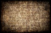 stock photo of mesopotamia  - Ancient grunge cuneiform assyrian or sumerian inscription on a clay tablet - JPG