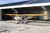 Ultralight Plane In Hangar