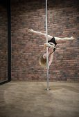 Blonde Nice Girl Training Pole Dance In A Studio poster