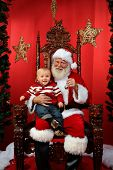 foto of lap  - Baby boy sitting on Santa - JPG