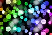 stock photo of heptagon  - Photo of bokeh lights on black background - JPG