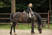 Child Smile In Rider Saddle On Animal Back. Girl Ride On Horse On Summer Day. Friend, Companion, Fri poster