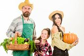 Harvest Festival Concept. Parents And Daughter Farmers Celebrate Harvest Holiday. Family Farmers Gar poster