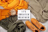 Flat Lay With Comfort Warm Outfit For Cold Weather. Lightbox With The Text Its Sweater Weather. Comf poster