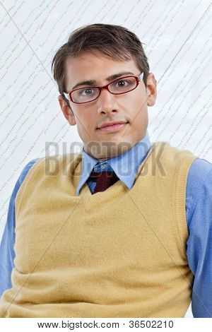 Portrait of smart young male business executive wearing eyeglasses over textured background
