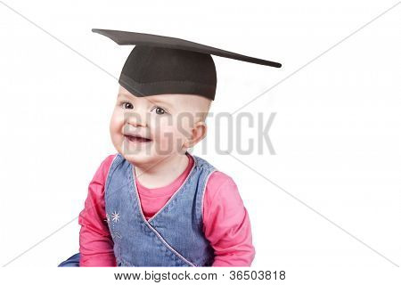 Young girl age 1 wearing a school graduation mrtar board hat