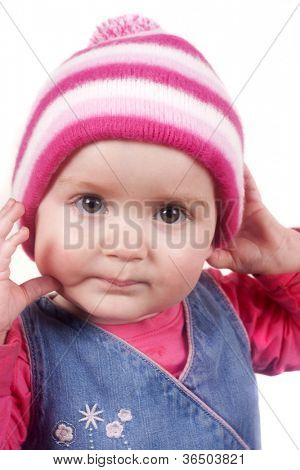 Bobble hat wearing toddler isolated on a white background
