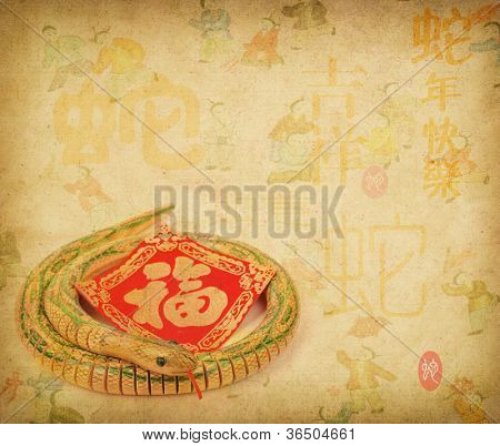 Year of the snake design on old paper background,chinese Calligraphy mean snake