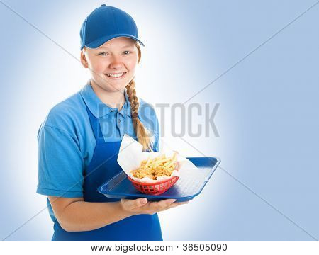 Teenage fast food worker holding a tray of chicken nuggets and fries. Blue background
