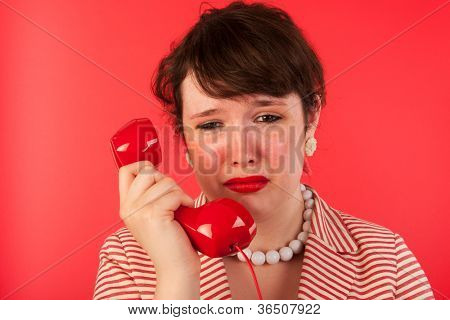 Woman crying while having a sad phone call