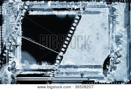 Computer designed highly detailed film frame on aged paper background , with space for your text or image. Nice grunge element for your projects