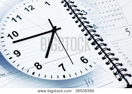 Clock face, calendar and diary page