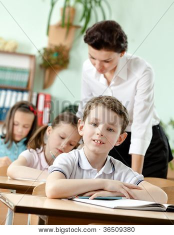 Teacher controls the task performing by her pupils