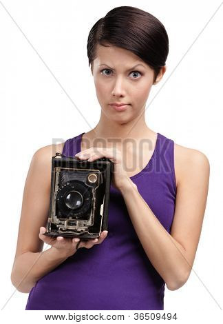 Woman with rarity photographic camera, isolated on white