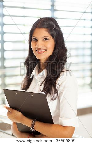 pretty young female office worker with clipboard