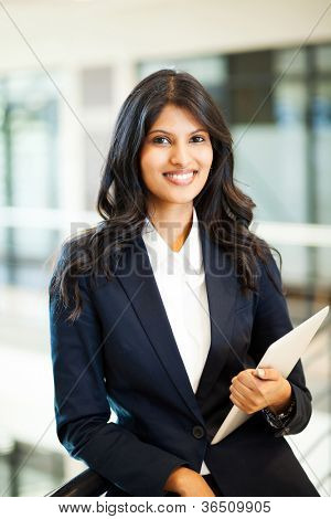 pretty asian businesswoman with tablet computer
