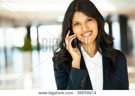 beautiful young indian businesswoman talking on cell phone