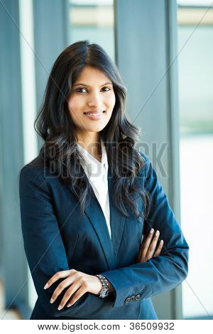 attractive female white collar worker in office