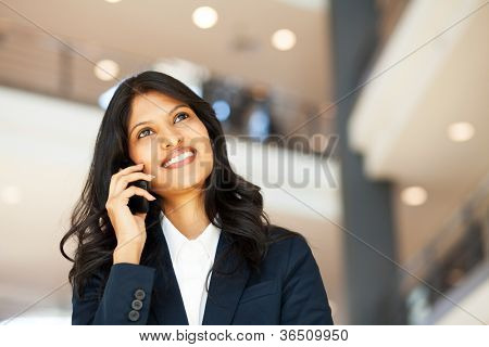 attractive young asian businesswoman talking on mobile phone