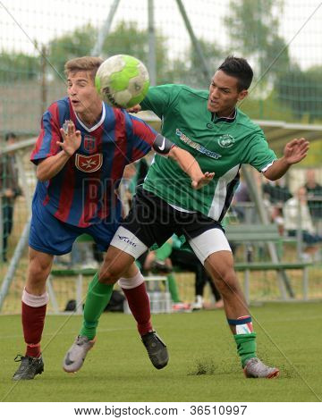 KAPOSVAR, HUNGARY - SEPTEMBER 1: Viktor somogyi (R) in action at the Hungarian National Championship under 18 game between Kaposvar (green) and Videoton (blue) September 1, 2012 in Kaposvar, Hungary.