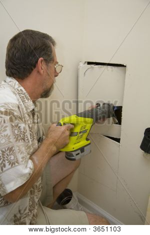 Plumber Cutting Access Hole