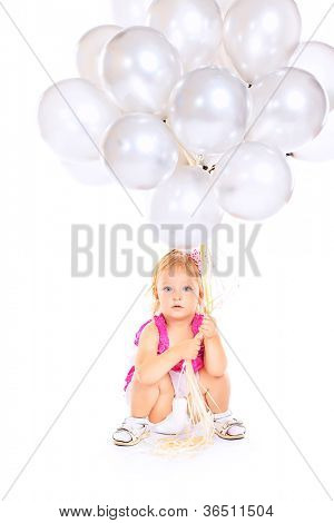 Happy little girl holding a lot of balloons. Isolated over white background.