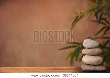 Stack of zen stones on table,Zen concept.