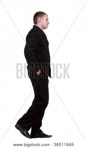 back view of walking sad business man. going young guy in black suit. Isolated over white background. Rear view people collection.  backside view of person.