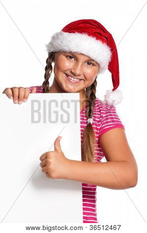 Portrait of happy girl in Santa hat with white blank