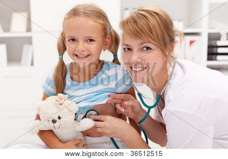 Little girl at the doctor's - pediatric checkup