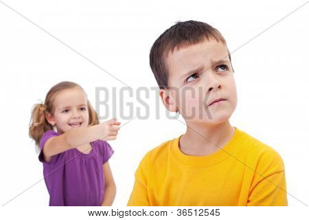 Bullying concept - girl mocking an upset young boy, isolated