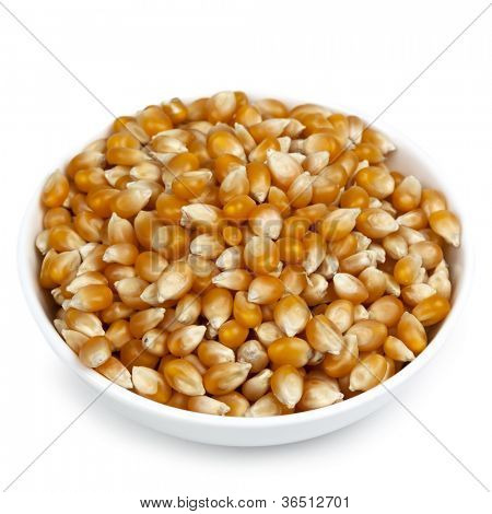 Bowl of popping corn, isolated on white background.