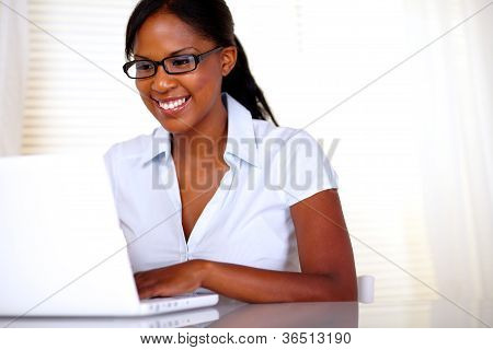 Smiling Woman With Black Glasses Working On Laptop