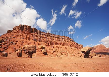 """Magnificent American red desert. Huge """"mushroom"""" from red sandstone. Solar midday sun"""