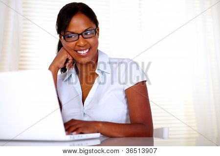 Afro-american Secretary Reading On Laptop Screen