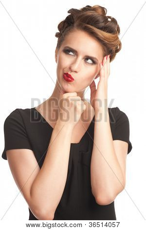 Portrait of pensive woman with vintage make-up and hairstyle touching her head. Isolated on white background