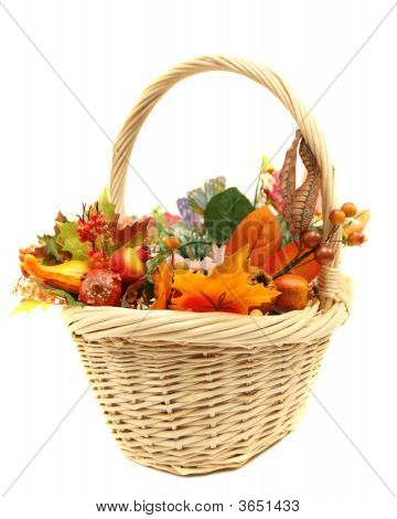 Seasonal Basket With Fall Leaves And Vegetables