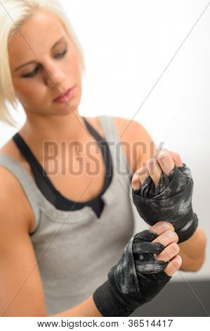 Kick-box woman wear protective gloves prepare for fitness workout