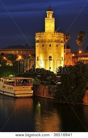A view of the Guadalquivir River and the Torre del Oro, in Seville, Spain, at night